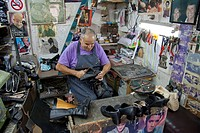 Freddie Caruana, shoe maker and repairer on St. Paul Street, Rabat, Malta