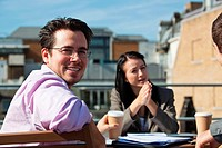 Three people in an outdoor meeting