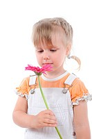 girl sniffs a flower.