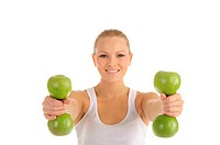 woman engaged in fitness dumbbells from apples