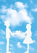 Blue sky and paper cutout of a couple facing each other