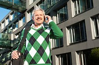 Germany, Bavaria, Mature man on phone, smiling
