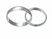 Two platinum or silver wedding rings on white chained together. High resolution 3D image.