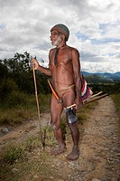 Dani Tribesman wearing Penis gourds, Baliem Valley, West Papua, Indonesia
