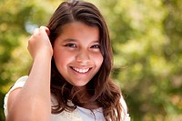 Cute Portrait of a Happy Hispanic Girl in the Park