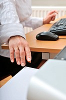 Hand of business woman reching paper from printer on workplace _ detail