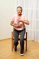 older woman is doing gymnastics _ senior s standing up of chair _ muscularity