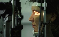 Eyes of a woman being examined with a slit lamp