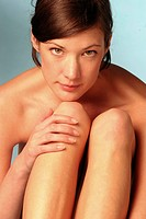 Act _ Young Adult Woman sits with absorbed legs the head on the knees