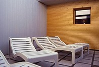 white Beachchairs in front of sauna