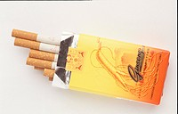An opened box of ginseng cigarettes with half pulled out cigarettes in front of white background