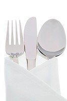 A knife with a fork and plate.Place setting for a dinner at the restaurant.