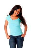 Beautiful happy smiling African Caribbean teenager standing with thumbs in pocket wearing blue shirt and jeans, isolated.