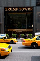 The doors and facade of the Trump Tower on 5th Ave on Manhattan Yellow taxis near the Trump Tower