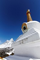 Buddhist stupa at Tengboche monastery with the mountain of Ama Dablam behind it, Everest Region, Nepal