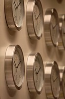 rows of clocks on the wall