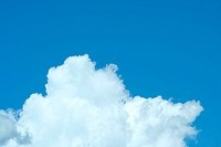 A Puffy white cloud with blue sky