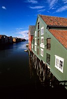 Warehouses in a row on waterfront of river Nidelva, Trondheim, Norway