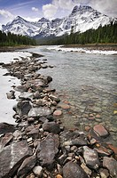 Snowy peaks and frozen river in the Canadian Rocky mountains Rockies on the way from Banff to Jasper