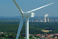 Aerial view of an alternator and propeller of a wind turbine with on background coal electricity power-plants at Carling Centrale Emile Huchet, Longev...