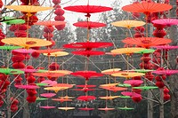 lanterns and umbrellas hanging in air