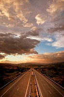 Cloudy sunset over highway