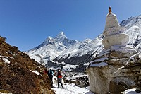 Trekkers walking below Ama Dablam mountain, Everest Region, Nepal