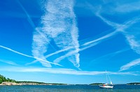 Blue sky full of airplane traces