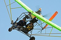Male pilot flying with female up in ultralight, Camarillo, California, USA