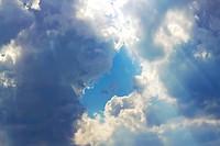 blue sky framed by clouds