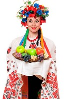 Young woman in the Ukrainian national clothes with fruit