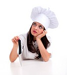 thoughtful lady cook keeping knife