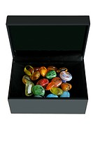 colorful glass stones in a black box