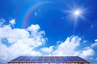 Blue Sky and Sun Over Solar Panels
