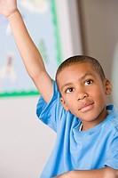 Schoolboy 6_7 raising hand