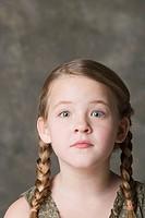 Portrait of girl 8_9 looking surprised, studio shot