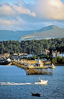 Bangor Pier and town, Gwynedd, north Wales, UK  Looking across the Menai Strait from Anglesey to the mountains of Snowdonia