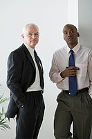 Two businessmen standing in office