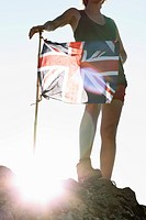 Hiker planting Union Jack flag