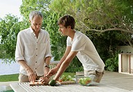 Father and son making salad outdoors