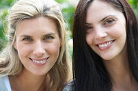 Close up of women's smiling faces