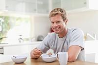Man eating breakfast in kitchen