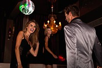 Smiling couple dancing in club