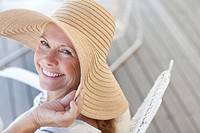 Portrait of smiling woman wearing sun hat