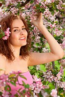 portrait of young lovely woman in spring flowers