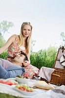 Young couple enjoying picnic in park