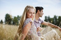 Couple sitting in rural field