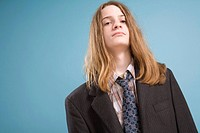 Teen Boy in Ill_fitting Suit