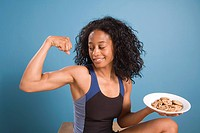 Woman Flexing with Cookies