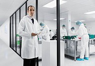 Scientist using tablet computer in lab